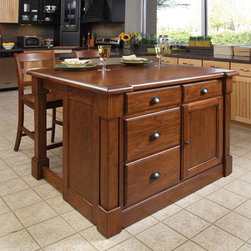 """Home Styles - Aspen Kitchen Island Set - Features: -Kitchen island and two bar stools.-Recessed door panels.-Four storage drawers and a storage cabinet.-Hidden sliding mechanism connected to the back two posts.-One adjustable shelf.-Mahogany solid and cherry veneers construction.-Rustic cherry finish.-Aspen collection.-Product Type: Kitchen Island.-Collection: Aspen.-Base Finish: Rustic Cherry.-Counter Finish: Wood.-Hardware Finish: Antique Brass.-Distressed: No.-Powder Coated Finish: No.-Gloss Finish: No.-Base Material: Wood.-Counter Material: Wood.-Hardware Material: Antiqued brass.-Solid Wood Construction: No.-Number of Items Included: 3.-Water Resistant or Waterproof: No.-Stain Resistant: No.-Warp Resistant: No.-Exterior Shelves: No.-Drawers Included: Yes -Number of Drawers: 4.-Push Through Drawer: No..-Cabinets Included: Yes -Number of Cabinets : 1.-Double Sided Cabinet: No.-Number of Interior Shelves: 2.-Adjustable Interior Shelves: Yes.-Number of Doors: 1.-Locking Doors: No.-Door Handle Design: Finger pulls..-Towel Rack: No.-Pot Rack: No.-Spice Rack: No.-Cutting Board: No.-Drop Leaf: Yes.-Drain Groove: No.-Trash Bin Compartment: No.-Stools Included: Yes -Number of Stools Included: 2.-Stool Finish: Same as island finish..-Casters: No.-Wine Rack: No.-Stemware Rack: No.-Cart Handles: No.-Finished Back: Yes.-Commercial Use: No.-Recycled Content: No.-Eco-Friendly: No.-Product Care: Clean with a damp cloth.Specifications: -ISTA 3A Certified: Yes.Dimensions: -Barstool seat height: 24''.-Overall Height - Top to Bottom: 36"""".-Overall Width - Side to Side: 48"""".-Overall Depth - Front to Back: 26.75"""".-Width Without Side Attachments: 48"""".-Countertop Width - Side to Side: 48"""".-Countertop Depth - Front to Back: 26.75"""".-Shelving: -Shelf Width - Side to Side: 16.75"""".-Shelf Depth - Front to Back: 19""""..-Leaf: -Leaf Width - Side to Side: 48"""".-Leaf Depth - Front to Back: 12.25""""..-Drawer: -Drawer Interior Height - Top to Bottom (Top Drawers) : 2.75"""".-Drawer Interior Height - Top to"""