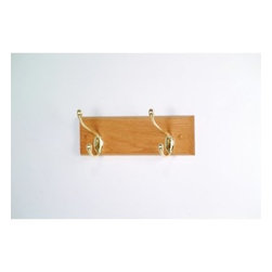 2-Hook Wooden Wall Coat Rack - The Two-Hook Coat Rack is a simple functional coat rack for any home or office setting. This coat rack is crafted from 3/4-inch solid red oak wood and features two double hooks for hanging up coats hats dog leashes and umbrellas. It's available in three attractive wood finishes to complement the furnishings in your bathroom office lobby entryway mudroom or any room in your home. Choose between brass or nickel hooks to coordinate with any decor style. About Wooden MalletFor over 20 years Wooden Mallet has been turning Northern Red Oak into beautiful and functional American-made wood products for commercial and residential settings. Wooden Mallet manufactures and distributes various styles of magazine and brochure display racks chart holders luggage racks coat and hat racks and reception chairs and tables crafted from solid oak sides and components. In addition to a technological manufacturing process Wooden Mallet also employs a unique finishing process using ultraviolet light to cure the finish into the wood for a more durable lasting finish. This process meets the emission standards set by the Environment Protection Agency. For the past 10 years Wooden Mallet has ranked consistently in the top 100 of the Wood & Wood Products Wood 100 Annual Report for Solid Wood and Panel Technology.