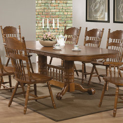 Coaster - Brooks Dining Table, Oak - The traditional oak table features a smooth oval top, with two 18 inch center leaves so you can easily extend the length of the table from 60 inches long to 78 or 96 inches long, so you can accommodate dinner guests. A double pedestal trestle base with pretty turned spindles. Pair with any chairs from this collection for a complete dining ensemble that will fit your needs.