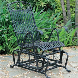International Caravan - Outdoor Glider Chair w High Back and Black-Fi - Glide to an enhanced outdoor appearance and pampered comfort with this porch glider. The chair features an easy gliding motion, contoured armrests, rugged iron construction and delicate scrollwork. Best of all, its weatherproof design ensures years of enjoyment. Designed by International Caravan. In Black finish. Made of iron. Single glider. Complete Premium Outdoor Rust and UV Light Fading Protection. Comfortable, smooth design. 23 in. W x 35 in. D x 43 in. H
