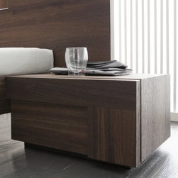 Air Right 1 Drawer Nightstand - If you believe style is as important as breathing, then get a little more oxygen with the ultra sleek Air Right 1 Drawer Nightstand. Engineered wood and veneer construction is sure to give your bedroom lasting charm and beauty. A warm walnut finish provides an elegant, modern appeal that's sure to complement any decor. As convenient as it is beautiful, this nightstand features a drawer so you can keep bedside necessities close at hand but out of sight.About Rossetto USARossetto USA is the U.S. division of the Arros Group, a leading manufacturer that exports Italian furniture style and design all over the world. Operating out of its warehouse in High Point, N.C., since 1999, Rossetto provides complete contemporary and modern dining, bedroom, and occasional furniture programs that combine affordable price with innovative Italian design to satisfy the demands of their distinguished customers.