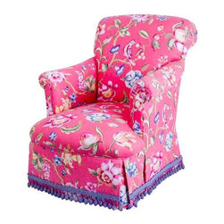 Pre-owned Skirted Club Chair in Pink Schumacher Fabric - This vivid chair would be perfect in a boudoir or tucked into a sunroom or parlor. It is upholstered in a beautiful Schumacher fabric with a tasseled fringe skirt. The casters add to its utility.