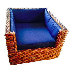 """Pre-owned Vintage Basket Weave Chair - A vintage basket weave chair from the 1960s. The chair has a vintage feel but it fits in well with contemporary decor - coastal, cottage, modern or traditional. New cushions were custom made to fit the seat as well as all three sides. It's extra deep at 27.5"""" which makes it the perfect chair to curl up and read a book in. The bottom cushion is extra firm and all the cushions are made from durable navy blue Sunbrella. There has been no restoration to the outside of the chair except for a coat of tong oil to clean it up. The bamboo/basket weave on the outside of the chair has a wonderful patina."""