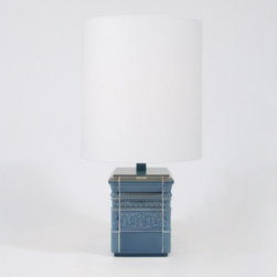 Lee Broom - Tile Lamp - Tile Lamp is available in a White Glazed Ceramic or Blue Glazed Ceramic finish with a White Cotton shade.  Available in small and large. The Tile Lamp collection explores the use of traditional glazed tile on lighting.   Oversized lamps are clad in various formations giving the impression of an upper surface of a tiled column.  The Tile Lamps use genuine traditional twice-fired tiles made the same way as many years gone by.  The moulds are hand carved and monogrammed for authenticity and are produced by the same factory that produces tiles for the London Underground.  One 40 watt, 120 volt A19/Medium base Incandescent lamp is required but not included.  Small: 9.45 inch width x 33.46 inch height.  Large: 9.45 inch width x 40.9375 inch height.