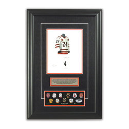 "Heritage Sports Art - Original art of the NHL 1971-72 Bobby Orr jersey - This beautifully framed piece features an original piece of watercolor artwork glass-framed in an attractive two inch wide black resin frame with a double mat. The outer dimensions of the framed piece are approximately 17� wide x 24.5� high, although the exact size will vary according to the size of the original piece of art. At the core of the framed piece is the actual piece of original artwork as painted by the artist on textured 100% rag, water-marked watercolor paper. In many cases the original artwork has handwritten notes in pencil from the artist. Simply put, this is beautiful, one-of-a-kind artwork. The outer mat is a rich textured black acid-free mat with a decorative inset white v-groove, while the inner mat is a complimentary colored acid-free mat reflecting one of the team�s primary colors. The image of this framed piece shows the mat color that we use (Orange). Beneath the artwork is a silver plate with black text describing the original artwork. The text for this piece will read: This original, one-of-a-kind watercolor painting of Bobby Orr's 1971-72 NHL All-Star team jersey is the original artwork that was used in the creation of this Bobby Orr jersey evolution print and tens of thousands of Bobby Orr products that have been sold across North America. This original piece of art was painted by artist Tino Paolini for Maple Leaf Productions Ltd. Beneath the silver plate is a 3� x 9� reproduction of a well known, best-selling print that celebrates Bobby Orr's hockey history. The print beautifully illustrates a chronological evolution of some of Bobby Orr's jerseys and shows you how the original art was used in the creation of this print. If you look closely, you will see that the print features the actual artwork being offered for sale. The piece is framed with an extremely high quality framing glass. We have used this glass style for many years with excellent results. We package every piece very carefully in a double layer of bubble wrap and a rigid double-wall cardboard package to avoid breakage at any point during the shipping process, but if damage does occur, we will gladly repair, replace or refund. Please note that all of our products come with a 90 day 100% satisfaction guarantee. Each framed piece also comes with a two page letter signed by Scott Sillcox describing the history behind the art. If there was an extra-special story about your piece of art, that story will be included in the letter. When you receive your framed piece, you should find the letter lightly attached to the front of the framed piece. If you have any questions, at any time, about the actual artwork or about any of the artist�s handwritten notes on the artwork, I would love to tell you about them. After placing your order, please click the ""Contact Seller"" button to message me and I will tell you everything I can about your original piece of art. The artists and I spent well over ten years of our lives creating these pieces of original artwork, and in many cases there are stories I can tell you about your actual piece of artwork that might add an extra element of interest in your one-of-a-kind purchase."
