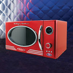 """Nostalgia Electrics - Retro Series 0.9 CF Microwave Oven in Red - Microwave in style with this unique and sleek retro-styled microwave oven from Nostalgia Electrics. Its oval window and chrome accents may have a classic look, but its 12 pre-programmed features, handy dial control, turntable and 800 Watts of cooking power offer every modern convenience. With a 0.9 cubic foot interior cavity, this unit is sized for everyday use. At home in any kitchen and great for a rec room or theater room. Another great item from the Nostalgia Electrics Retro Series family of products. Features: -Microwave oven. -Color: Red. -0.9 cubic foot capacity. -Unique sleek, retro styling with chrome accents. -Dial controls feature 12 pre-programmed settings for a variety of different foods. -LED display with digital clock. Specifications: -Interior dimensions: 12.5"""" H x 8"""" W x 11.5"""" D. -Exterior dimensions: 11"""" H x 19"""" W x 14"""" D."""