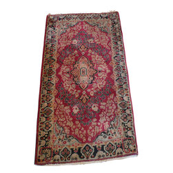 2'7 x 4'10 Antique Sarouk Rug - A Sarouk Rug is a type of Persian Rug from province of Arak in Iran.  Sarouk rugs have been produced for much of the last century. The early successes of the Sarouk rug are largely owed to the American market. From the 1910s to 1950s, the �American Sarouk� also known as the �Painted Sarouk� was produced. American customers had an affinity for the Sarouk�s curvilinear and floral designs. What they did not appreciate, however, was the color, so for much of the 1920s, 30s and 40s, rugs exported from Iran would get a dye job to a desirable, deep, raspberry-red color, once they made it to the States.