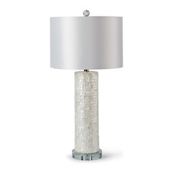 Kathy Kuo Home - Sapelo Coastal Beach Ivory Capiz Shell Table Lamp - Capiz shells are layered in a scalloped pattern around the rising pedestal of this table lamp. Shimmering shades of white, ivory and alabaster delicately decorate the classic column, resting on a polished silver, circular base. A crisp, white drum shade tops off this coastal creation.