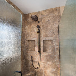 Bathroom Remodels - Tiled shower with glass door. Photo by Andrea Hanks Photography.