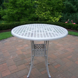 Oakland Living Corp - Oakland Living Elite Cast Aluminum 42 in. Bar Height Patio Dining Table - Beach - Shop for Fire Pits and Fireplaces from Hayneedle.com! When entertaining outdoors an extra table always comes in handy and the Oakland Living Elite Cast Aluminum 42 in. Bar Height Patio Dining Table - Beach Sand offers just that additional help. At bridal or baby showers this table works perfectly for holding and presenting gifts; at outdoor brunches or luncheons it provides easy access to extra settings serving dishes or beverage pitchers or for dirty dishes; and at open houses it acts as an area for people to gather around as they mix and mingle. What also makes this piece so spectacular for party planning is that it cleans up easily before and after each use and it is attractive enough on its own that it doesn't require any extra work from you to decorate it - the folks at Oakland Living already took care of that with its beautiful design. Part of the Elite collection by Oakland Living this table bears the collection's signature basket weave tabletop and leg braces and will complement perfectly any home design. The high quality workmanship of this hand cast piece with its beautiful and sunny beach sand finish that won't fade chip or crack guarantees that it will be in your collection long enough for you to enjoy its services time and again year after year.