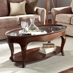 "American Drew Cherry Grove The New Generation Oval Coffee Table - A new generation of style is ascending — the American Drew Cherry Grove The New Generation Oval Coffee Table is a stunning example. This durable table is crafted of high-quality engineered wood, finished in an exquisite mid-tone brown finish, and outfitted with a lower display shelf.About American DrewFounded in 1927, American Drew is a well-established, leading manufacturer of medium- to upper-medium-priced bedroom, dining room, and occasional furniture. American Drew's product collections cover a broad variety of style categories including traditional, transitional, and contemporary. Their collections range from the legendary 18th-century traditional """"Cherry Grove,"""" celebrating its 42nd year of success, to the extremely popular """"Bob Mackie Home Collection,"""" influenced by the world-renowned fashion designer Bob Mackie. """"Jessica McClintock Home"""" features another beloved designer bringing unique style to an American Drew line. American Drew's headquarters are located in Greensboro, N.C. Their products are distributed through thousands of independently owned retailers throughout the United States and Canada and around the world."