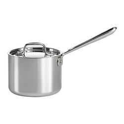 All-Clad® Stainless 2 qt. Saucepan with Lid - Put the cookware that's found in many four-star kitchens to work for you. This professional-grade saucepan has an extra-thick aluminum core that extends from the bottom all the way up the sides for even heat distribution. Bonded to the aluminum core is a hand-polished 18/10 stainless interior that won't react with food and a magnetic stainless exterior polished to a high shine. Tight-fitting stainless lid locks in heat, moisture and flavor. The long, securely riveted stainless handle stays cool while cooking. Handcrafted in Pennsylvania, this dishwasher-safe cookware is perfect for everyday use with traditional electric or gas ranges, as well as induction cooktops.