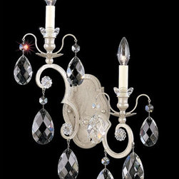 Schonbek - Renaissance New Antique Silver Two-Light Clear Heritage Handcut Crystal Wall Sco - -Heritage Handcut Crystal: This crystal is cut by hand in two stages on an iron and then a sandstone wheel. Each crystal is then polished on a wood wheel with marble dust. The most authentic handcrafted crystal in the world.  - This baroque style of chandelier dates back to the court of King Louis XIV in the seventeenth century. Schonbek's bold mix of crystal trims and finishes adds a flavor of twenty-first century eclecticism. Also Made with Swarovski Elements.  -Clear Heritage Handcut  - Light Source: Incandescent Bulb  - Bulbs not included  - Uses standard line volt dimmer  - Some assembly required  - For shipping outside of USA, please contact Bellacor customer service  - Cleaning and Care Instructions: Every Schonbek product is of heirloom quality and will last for generations. To ensure it retains its brilliance and splendor for years to come, proper care and regular cleaning are necessary. It is recommended that Schonbek products, and particularly their crystal trim, be lightly dusted with a feather or lambswool duster, or soft brush every two months, or whenever it appears dull or dusty. Consult the fixtures trim diagram for detailed cleaning instructions list of approved cleaning solutions. Schonbeck fixtures should never be subjected to any chemical cleaning agents. - See packaging insert for warranty information. Schonbek  - 3757-48