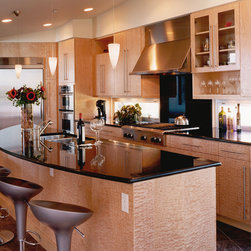 Kitchen Cabinetry - Contemporary Modern European Style - Highlight the beauty of the natural figuring (grain) of the wood by book matching. The kitchen cabinetry shown here is frameless European style and is of book matched quilted maple. Cabinetry By: BKI Woodworks, Boulder, Colorado, www.bkiwoodworks.com.