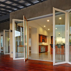 LaCantina Aluminum Wood Bifold Doors - The Aluminum Wood system is our unique design innovation based on the same styling as our traditional wood clad door.  Built with the highest quality components and latest engineering, the Aluminum Wood system is a great all around performer.
