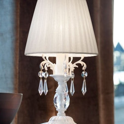 """6161/6166 TL1 P Table Light - The 6161/6166 TL1 P Table Light is part of a collection of High End light fixtures designed by Studio Stile Masiero in Italy for Masiero. This table lamp is a beautiful and harmonious piece that brings to classicism and modernism a new perspective. 6161/6166 table lamp is an elegant light fixture consisting of a golden solid brass or a white painted metal base and stand. One white organza lampshade is hidding the light bulb and is decorated with hanging chains of Asfour crystals. This is a stylish and contemporary table lamp that will light up any environment. Illumination is provided by E14 40W Incandescent bulb (not included).     .proddesc p{font-family: Verdana, sans-serif; font-size:8pt!important;}   .pdtable{font-family: Verdana, sans-serif; font-size:8pt!important;padding:10px;} Product Details: The 6161/6166  TL1 P Table Light is part of a collection of High End light fixtures designed by Studio Stile Masiero  in Italy for Masiero. This table lamp is a beautiful and harmonious piece that brings to classicism and modernism a new perspective. 6161/6166 table lamp is an elegant light fixture  consisting of a golden solid brass or a white painted metal base and stand. One white organza lampshade is hidding the light bulb and is decorated with hanging chains of Asfour crystals. This is a stylish and contemporary table lamp that will light up any environment. Illumination  is provided by   E14 40W Incandescent    bulb (not included). Details:                         Manufacturer:            Masiero                            Designer:            Studio Stile Masiero                            Made in:            Italy                            Dimensions:                        Height: 12.2""""(31cm) X Diameter: 6.3""""(16cm)                                         Light bulb:                        E14, 1x40W Incandescent bulb (not included)                                         Material:            Metal, Crystal, Fabric"""