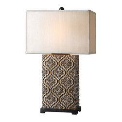 Uttermost - Curino Golden Bronze Table Lamp - If you could only have one lamp, this one would certainly be in the running. A stunning piece of sculpture, this intricate bas-relief base with golden bronze detail overlaid with silver champagne accents is reason enough to forsake all others.