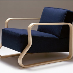 Artek Alvar Aalto 44 Armchair - I love when an iconic piece of mid-century modern furniture is super-cush and comfy! This classic chair designed by Alvar Aalto is often seen in a zebra print, and is part of quite a few museum's archives. My favorite use of it is in his own studio