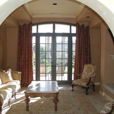 Draperies - Pleated chenille side panels attached to wall with concealed rings and no visible hardware. Shaped to fit curvature of window.