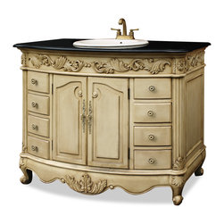 China Furniture and Arts - Antique Beige Vanity with Granite Top - This two door vanity comes complete with a granite top, white ceramic sink, and brass faucet. The entire cabinet features a hand carved acanthus leaf motif to enhance its elegant charm. Eight drawers allow for plenty of storage of household items. Fully assembled.