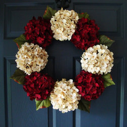 Stately Hydrangea Wreath from HomeHearthGarden - A prominent hydrangea wreath arrangement in subtle cream and burgundy colors that makes for distinguished door decoration. This elegant wreath is handcrafted on a grapevine base with artificial hydrangea flowers and leaf greenery accents around wreath perimeter.