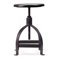 Stockton Table Height Stool - Righty-tighty, lefty-loosey. You might find yourself saying one of these familiar phrases when you need to adjust the height of this captivating stool. It, along with the memorable expression, confirms that some classic things just never go out of style.