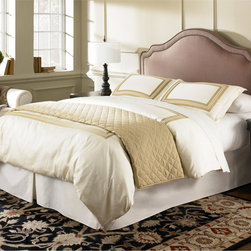 Fashion Bed Versailles King/Cal-king Upholestered Headboard - Curved or square, plain or embellished with nailhead trim, there are so many varieties of upholstered frames to choose from. This curved one with trim is very classic.