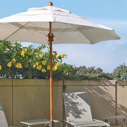 "FiberBuilt Bridgewater 8-ft. Fiber Teak Contract Patio Umbrella - Stay cool and comfortable under the 8-Foot Bridgewater Contract-Grade Patio Umbrella. Commercial-grade construction and top-quality materials set this umbrella apart from the rest. Able to withstand heavy use and unanticipated elements this umbrella has eight fiberglass ribs that hold the canopy for added strength in windy environments. Designed to let the air flow through the canopy has a vent at its top which promotes air flow reducing stress to the umbrella. The Sunbrella canopy material is a marine-grade fabric which will outlast any ordinary umbrella.The one-piece aluminum-reinforced pole is finished in a durable FiberTeak overlay which simulates a traditional wood pole finish. This 1.5-inch-diameter pole looks and feels like real wood but it is stronger and more durable. While all hardware is stainless steel the hub which is the primary element that raises and lowers the canopy is made of solid-wood for durability.The 8-Foot Bridgewater Contract-GradePatio Umbrella has all the features of a commercial-grade product yet it is also a terrific choice for your home patio or pool area. A variety of canopy colors and patterns are available so you can coordinate with your outdoor decor.Umbrella pole has a 1-year warrantyFiberglass ribs have a 3-year warrantyMarine-grade Sunbrella fabric has a 5-year warranty against fading Item shown above in Natural.More About FiberBuilt Umbrellas FiberBuilt Umbrellas is dedicated to manufacturing state of the art fiberglass ribbed umbrellas for use at hotels condominiums country clubs and restaurants as well as many other locations requiring contract quality products. The unique fiberglass support rib construction ensures strength resilience and durability. FiberBuilt has developed unique lines of contract quality Beach Garden and Market umbrellas that will hold up to the harshest weather conditions. Umbrellas constructed with Marine Grade fabric will withstand intense sunlight salt air and driving rain. The flexible fiberglass ribs absorb wind gusts without breaking and last four to five times longer than traditional steel or wood ribbed umbrellas. About SunbrellaSunbrella has been the leader in performance fabrics for over 45 years. Impeccable quality sophisticated styling and best-in-class warranties prove the new generation of Sunbrella offers more possibilities than ever. Sunbrella fabrics are breathable and water-repellant. If kept dry they will not support the growth of mildew as natural fibers will. Beautiful and durable Sunbrella is a name you can trust in your outdoor furniture.Cleaning and Caring for SunbrellaRegular maintenance is the best way to keep your Sunbrella fabrics looking good and delay deep vigorous cleaning. Brush off dirt before it becomes embedded in the fabrics and wipe up spills as soon as they occur. For light cleaning use a mild soap and water solution and a sponge allowing your cleaning solution to soak into the fabric. Rinse thoroughly to remove all soap residue and allow fabric to air dry. For more specifics on maintaining Sunbrella fabrics visit Sunbrella.com.Sunbrella fabrics have been tested to provide up to 98% UV protection depending on depth of color. Whites and lighter colored fabrics provide less protection than darker fabrics. This protective factor is inherent to the product and will not diminish through use or exposure to the sun. Sunbrella furniture and umbrella fabrics have been awarded the ""Seal of Recommendation"" by the Skin Cancer Foundation an international organization dedicated to the prevention of skin cancer. Beautiful and protective fabric is the hallmark of Sunbrella."