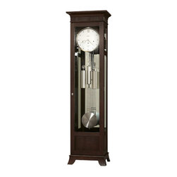Howard Miller - Kristyn 83rd Anniversary Floor Clock - This floor clock a sophisticated flat top design with reeded panel inserts and a gracefully curved base. Features: -Brushed nickel finish. -Hardwoods and veneers construction. -Glass mirrored back panel. -Beveled glass on the front and sides. -Removable glass, top side panels offer easy access to the movement. -Cable-driven, Westminster chime Kieninger movement with automatic nighttime chime shut-off option. -Case is illuminated by an interior light. -Locking door for added security. -Adjustable levelers under each corner provide stability on uneven and carpeted floors. -Heirloom record certificate with capsule is included for recording your clock's ownership history for future generations. -Free heirloom plate, engraved with name and date, by returning the enclosed request card to Howard Miller. -Made in the USA.
