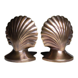 "Inviting Home - Shell Bookends - bookends with shell design 5-1/4""H x 4-1/4""W x 5-1/4""D (each) hand-cast solid brass in antiqued finish Set of two hand-cast solid brass bookends with shell design. Bookends have antiqued finish and felt lining on the bottom."