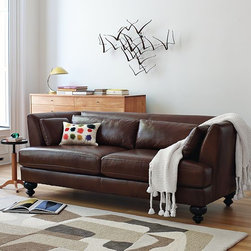 Essex Leather Sofa - Overstuffed but far from stuffy, this low-slung, sophisticated sofa combines a gently curving silhouette with top-grain leather upholstery and solid wood legs to turn heads and command attention wherever it goes. The sofa is assembled at west elm's own facility in the USA, where it's built using sustainably harvested wood certified by the Forestry Stewardship Council (FSC) and finished with a bevy of recycled materials.