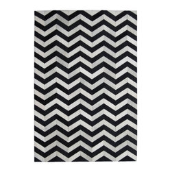 Madisons Inc. - Black & Cream Modern Chevron Cowhide Rug, 9' X 12' - The Black and Cream Chevron Cowhide Rug is a natural hair-on-hide area rug that has been made in India. The design, offering a chevron pattern in contrasting black and cream hides, makes an elegant statement in any well-appointed modern or contemporary space. This rug is reserved for those who relish high design and style, as it is made by highly-skilled artisans. The cowhide has been ethically sourced in India and tenders shorter hair than those from other parts of the world as a result. Not only does this piece make a statement, but sustains the livelihood of many villages in India from which they are produced.