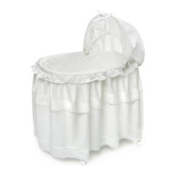 Badger Basket White Batiste Long Skirt Portable Bassinet n Cradle with Toybox Ba - The Badger Basket White Batiste Long Skirt Portable Bassinet n Cradle with Toy Box Base is a beautiful and practical choice for any family. Designed to convert to a toy box when your baby has outgrown the bassinet, you'll love having a bassinet that can be used for more than a few months. Featuring a mesh basket so you can store diapers, wipes, burp cloths, and other necessary items, this bassinet can also be lifted off its base so you can keep your baby by your side wherever you are (never carry the bassinet with your baby inside). Castor wheels makes it so you can move this bassinet from room to room (again, not with baby inside), or you can flip up the wheels and convert the bassinet to a rocking bassinet making it easier to soothe your baby when he fusses. Complete with a classic white, quilted liner, floor-length skirt, adjustable canopy, fitted sheet, and mattress pad, the bassinet has everything you need for your baby's arrival. The mattress pad is covered in vinyl for easy cleaning, and the bedding is also machine-washable. Some assembly is required.Additional FeaturesClassic white liner and skirtCaster wheels makes moving bassinet simpleConverts to a rocking cradleQuilted liner, skirt, canopy, sheet, and pad includedAdjustable canopyVinyl covered pad is easy to cleanBedding is machine washableIllustrated instructions includedSome assembly requiredBadger Basket CompanyFor over 65 years, Badger Basket Company has been a premier manufacturer of baskets, bassinets, bassinet bedding, changing tables, doll furniture, hampers, toy boxes, and more for infants, babies, and children. Badger Basket Company creates beautiful and comfortable products that are continually updated and refreshed, bringing you exciting new styles and fashions that complement the nostalgic and traditional products in the Badger Basket line.