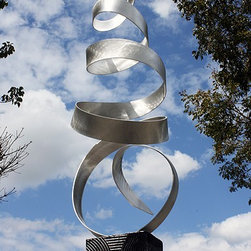 Breeze / Metal Abstract Art - This sculpture is striking. The spiraling form really does look like it's moving in the wind. I can imagine that image magnified by the sun striking it on a summer day. It would make a unique addition to any contemporary outdoor space.