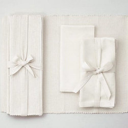 "Origin Crafts - White solid napkins set of 4 (two sets left) - White Solid Napkins Set of 4 Napkins and Placemats sold separately. Sets of four tied together w/matching twill tape. 100% cotton. machine wash cold water; tumble dry low. Dimensions: Napkins - 20"" x 20"" By Tag Ltd. - Tag Ltd. is a supplier of decorative accessories. Estimated Delivery Time 5-10"