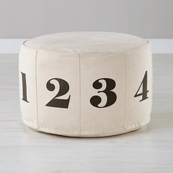 Numbers Pouf, Natural - Is it a footrest, stool, chair or table? This pouf will definitely make its way around the room.