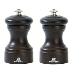 "Peugeot - Peugeot Bistro 4"" Chocolate Salt & Pepper Mill - This Peugeot Bistro Salt & Pepper Set evokes the feel of a classic Parisian eatery. Made of select French beech wood with a chocolate brown lacquer finish, they add an additional touch of elegance to your table top. The grind is adjusted by turning the top nut: turn it clockwise (tighten) for a finer grind; counter-clockwise (loosen) for a coarser grind.  The entire Peugeot mill is guaranteed against manufacturing and materials defect for 2 years from the date of purchase, however the grinding mechanism carries a similar guarantee for lifetime. These guarantees do not cover normal wear, accidental damage or any use not in accordance with the instructions provided. Save 15% when you buy the Salt & Pepper grinder together!"