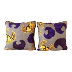 """Purple & Yellow African Wax Throw Pillows - A Pair - These short run designs are rich and vibrant.  The colorful fabrics are a true reflection of authentic African culture. This beautiful pair of 20"""" x 20"""" throw pillows in brown, yellow and purples.  The pattern is reminiscent of a tree kissing the African sky.  Features a fabric boarder trim. Made of 100% cotton, naturally breathable and free of chemical dyes. Poly filled with removable inserts and an invisible zipper. Hand or machine washable on a gentle cycle. Appropriate for outdoor usage however not waterproof."""