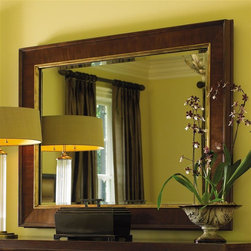Lexington Furniture - St. Tropez Grace Mirror - 1-inch beveled glass. Corsica accents. Can be hung horizontal or vertical. Hardware is custom designed in champagne gold finish. Warranty: For casegoods one year limited and for frame limited lifetime. Made from quartered and cathedral walnut veneers on select hardwood solids. Rich Walnut brown finish with medium luster. Plate size: 43 in. W x 30 in. H. Overall: 52.25 in. W x 39.25 in. H (65 lbs.). Special Care Instructions from Lexington FurnitureSt. Tropez is an elegant interpretation of transitional design. While the collection has a couture appeal, the designs reflect an unpretentious feeling of luxury and comfort. The resort of St. Tropez is an international destination, with a marvelous blend of cultures, fashion and style. The roots are solidly traditional, but the vibe is chic and casual. The common thread, from a design point-of-view, is elegance without pretense. That is the essence of this collection glamour redefined. Where the beauty of traditional meets the sparkle of contemporary. St Tropez is an elegant interpretation of timeless transitional design. Shimmering silks and soft velvets take their cue from couture fashion. Every texture, every detail is purposely designed to distinctly surround and affirm the home in beauty and glamour.