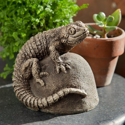 Campania International - Campania International Ike The Lizard Cast Stone Garden Statue - A-429-AL - Shop for Statues and Sculptures from Hayneedle.com! About Campania InternationalEstablished in 1984 Campania International's reputation has been built on quality original products and service. Originally selling terra cotta planters Campania soon began to research and develop the design and manufacture of cast stone garden planters and ornaments. Campania is also an importer and wholesaler of garden products including polyethylene terra cotta glazed pottery cast iron and fiberglass planters as well as classic garden structures fountains and cast resin statuary.Campania Cast Stone: The ProcessThe creation of Campania's cast stone pieces begins and ends by hand. From the creation of an original design making of a mold pouring the cast stone application of the patina to the final packing of an order the process is both technical and artistic. As many as 30 pairs of hands are involved in the creation of each Campania piece in a labor intensive 15 step process.The process begins either with the creation of an original copyrighted design by Campania's artisans or an antique original. Antique originals will often require some restoration work which is also done in-house by expert craftsmen. Campania's mold making department will then begin a multi-step process to create a production mold which will properly replicate the detail and texture of the original piece. Depending on its size and complexity a mold can take as long as three months to complete. Campania creates in excess of 700 molds per year.After a mold is completed it is moved to the production area where a team individually hand pours the liquid cast stone mixture into the mold and employs special techniques to remove air bubbles. Campania carefully monitors the PSI of every piece. PSI (pounds per square inch) measures the strength of every piece to ensure durability. The PSI of Campania pieces is currently engine