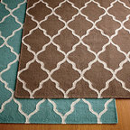 Tile Rug - Although there are only two color choices, both are beautiful. This quatrefoil pattern is busy, but not so busy that you'd want to cover it up.