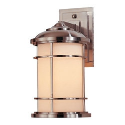 Feiss Lighting - 14-Inch Outdoor Wall Light - OL2201BS - This contemporary outdoor wall light was designed with the style of a lighthouse in mind. Mounted against the wall with a subtly stepped rectangular base, this sturdy fixture is constructed of die-cast zinc, with the bars of its shade's cage made of solid brass. Its glass is a lovely cream color, and the sleek brushed steel finish is a triple-plated and powder-coated lacquer for durability and weather resistance. Measures 14 inches in height, extends 9 inches from the wall, and Backplate measures 7-1/2 inches long by 4-1/2 inches wide. Takes (1) 100-watt incandescent A19 bulb(s). Bulb(s) sold separately. Wet location rated.