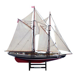 """Handcrafted Model Ships - Bluenose 2 Limited 24"""" - Wooden Sailboat Centerpiece - Sold Fully Assembled Ready for Immediate Display - Not a Model Ship kit. These Limited Edition scale replica yacht models of the famous Canadian schooner Bluenose 2 are sure to please discriminating sailing boat aficionados and racing yacht enthusiasts alike with their fine detailing and precise craftsmanship. Emanating the winning spirit of their namesake, these detailed scale yacht models are the perfect size for display upon any table, shelf or desk while adding a touch of classic elegance to the room they grace. 24"""" L x 4"""" W x 20"""" H (1:80 scale)."""