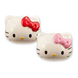Hello Kitty - Hello Kitty Salt & Pepper Shakers - Add a darling dash of flavor to any meal with this Hello Kitty shaker set! Carefully crafted in the shape of the adorable girl's head, they're a supersweet way to spice up meals.   Includes two shakers Each: 3.25'' W x 2.75'' H x 2.75'' D Ceramic Hand wash Imported