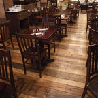 All-American Pub Floor in Oak - This project is a restaurant in Manhattan. The owner needed a durable floor that would bring the rustic feel, but also complement the formal setting.  The end look was fantastic!