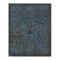 "Nourison - Nourison Timeless TML02 5'6"" x 8' Peacock Area Rug 21020 - Shimmering like peacock feathers with an almost magical iridescence, this remarkable carpet is based on a 17th century ""Polish"" design made at the Persian court manufactory of Kashan. Formerly in an Imperial collection, the original is a museum piece knotted in silk brocade on cotton. Its hexagonal middle panel enclosed by arabesques was executed in twelve colors with a general light tone. While faded by time, its beauty is the inspiration for this resplendent carpet which presents a luxurious field of blues ranging from indigo to lapis. Its traditional motifs include palmettes, arabesques and cloud bands similar to the original, with floral and geometric details finely figured in accent colors of ebony and ruby red."