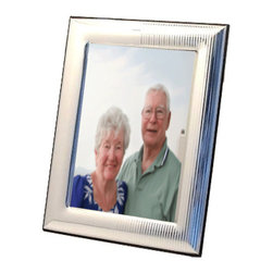 "Silverstar International - 5""x7"" Delaware Sterling Silver Frame - Celebrate a never-ending love that continues to grow with our 3rd anniversary Delaware sterling silver picture frame. Perfect for displaying wedding photographs, the Delaware frame has a lovely contemporary design with vertical stripes on the right side opposite to a smooth contour side on the left. This Silverstar International 925 bi-laminated sterling silver picture frame has a mahogany wood back with a slide tab closure for easy access to your most cherished photographs. All Silverstar picture frames have a tarnish resistant surface for carefree use and glare resistant glass. Create a cherished keepsake and custom engrave that special message for the one you love. Francesco Moretti"