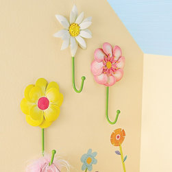 Daisy Days Iron Wall Hooks - These sweet daisy wall hooks are bound to add the finishing touch to your little girl's floral-inspired space. Help her learn independence as she hangs her things on these beautiful and lead-free hooks. A perfect way to add a 3-D touch to a room full of flowers.
