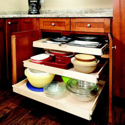Single-Height Pull Out Shelves - Create more usable storage space within your existing cabinets by replacing your fixed shelves with custom pull out shelves from ShelfGenie of New Jersey.  We're all familiar with the traditional cabinet that has a shelf and then a half-shelf above it.  Compare that with this cabinet that features three full-size pull out shelves, each with the ability to hold 100 pounds and extend completely.  A better way to get organized!