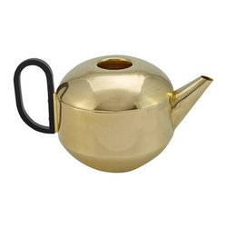 Tom Dixon - Form Teapot | Tom Dixon - Design by Tom Dixon, 2013. Tom Dixon's Form Tea components re-define modern elegance in polished brass and sharply defined shapes for formal entertainment. The Form Teapot is an archetypical British mascot. This rounded teapot made from spun brass is polished and then dipped in a warm gold wash to give a subtle matte surface. Its handle has a wrapped black leather strap which contrasts both the material and shape of its companion vessel. Features an etched logo on base. The Form Teapot is part of a six-piece set which includes a Tea Caddy, Jug, Milk Jug, Sugar Dish & Spoon and Tray. All ECLECTIC pieces arrive in gift packaging that is Graphic, Bold and Confident. Packaging is intentionally intriguing to heighten the experience of the product through anticipation and the ceremony of opening it - be it a gift for another or just for you. Enjoy!